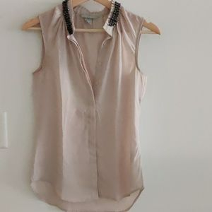 Cream coloured sleeveless top in size 32 from Hnm.
